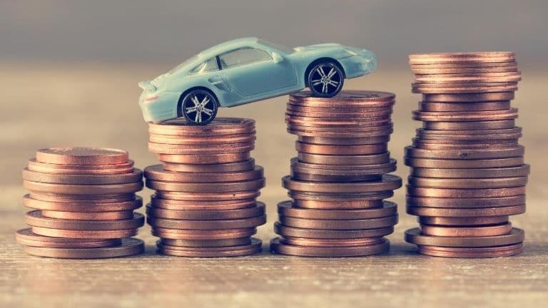 car and stacks of money
