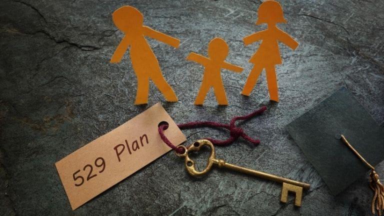 family cutouts standing next to 529 plan key