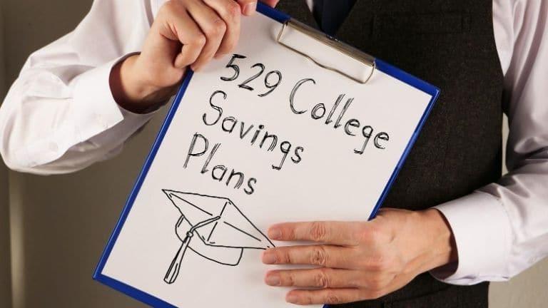 man holding 529 college savings plan sign