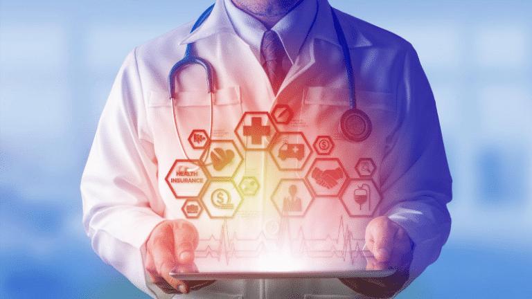 doctor holding health insurance